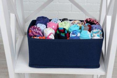 Socks in textile box on shelf