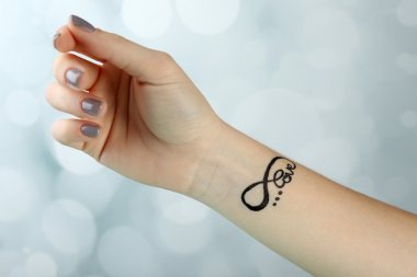 Female arm with tattoo