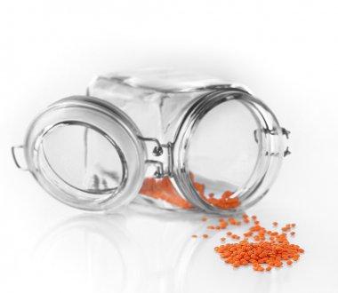 Remnants of lentils in glass jar