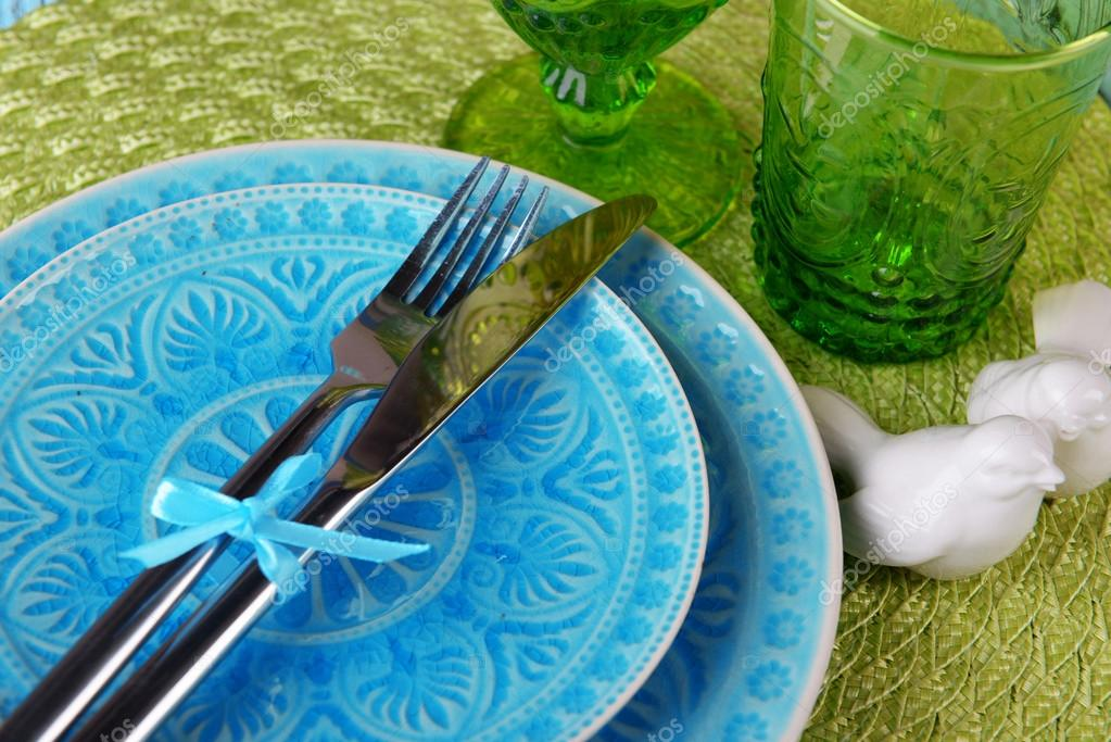 Empty colorful plate glasses and silverware set on wooden table \u2014 Stock Photo & Empty colorful plate glasses and silverware set on wooden table ...