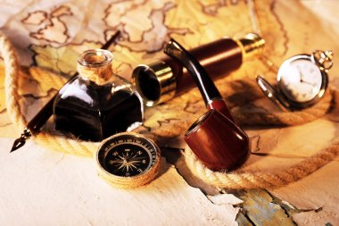 Marine spyglass and world map