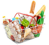 Fotografie Metal shopping basket with groceries isolated on white