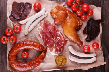 Assortment of deli meats on parchment, closeup