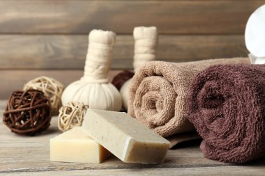 Beautiful spa composition with soap and candles on wooden background
