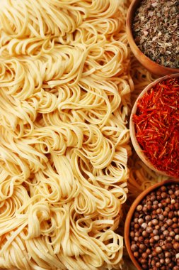 Different dry instant noodles with spices close-up stock vector