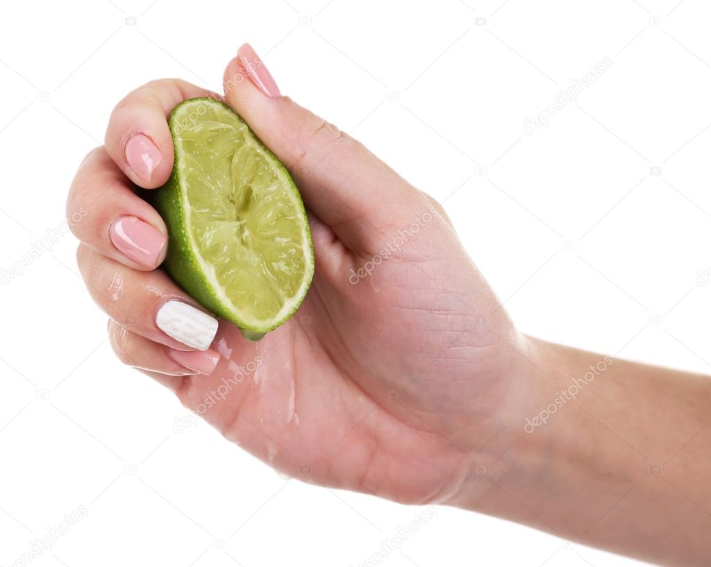 Female hand squeezing lime isolated on white — Stock Photo ...