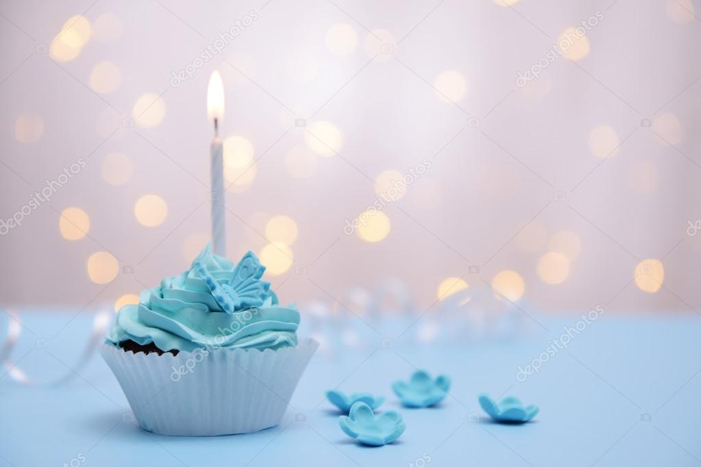 delicious birthday cupcake on table on light background  u2014 stock photo  u00a9 belchonock  68104913