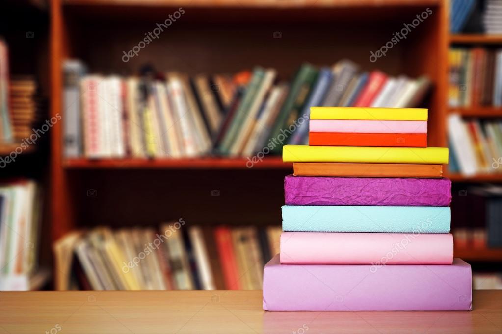 Stack Of Books On Table Bookshelves Background Stock Photo
