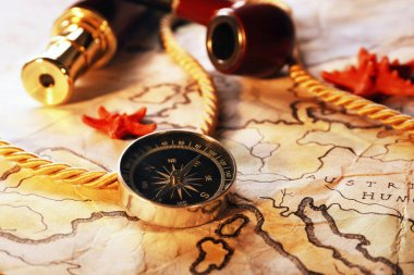 Marine still life with world map and spyglass on wooden table background