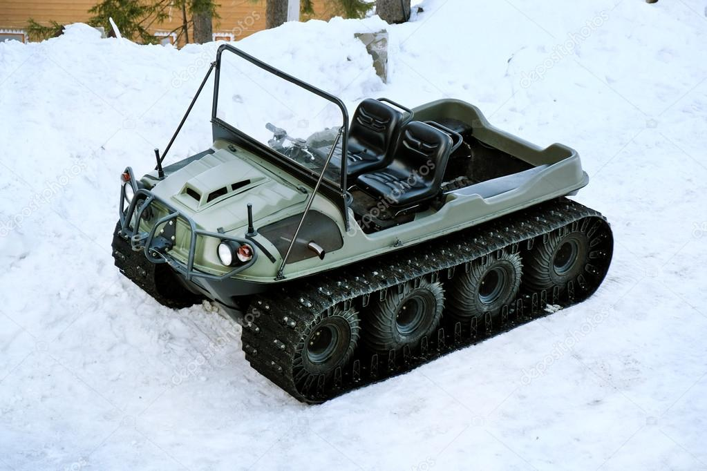 Snowmobile over snow in wintertime
