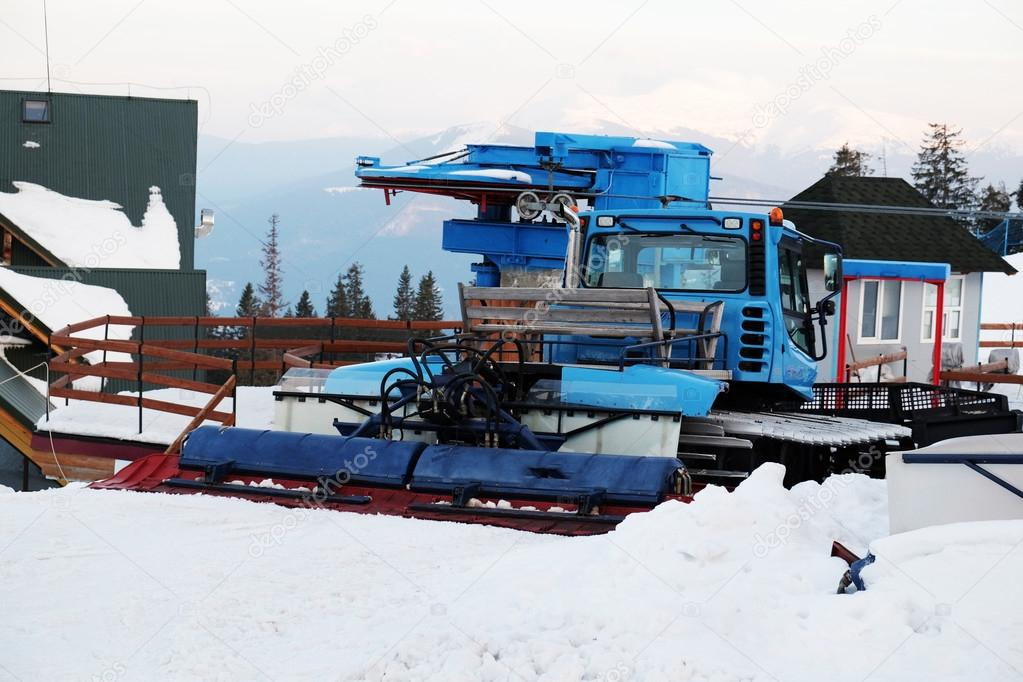 Snow removal equipment on snow and blue sky