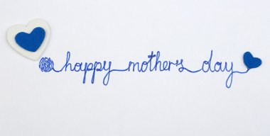 Happy Mothers Day message written on paper close up