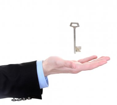 Business man hand with key isolated on white