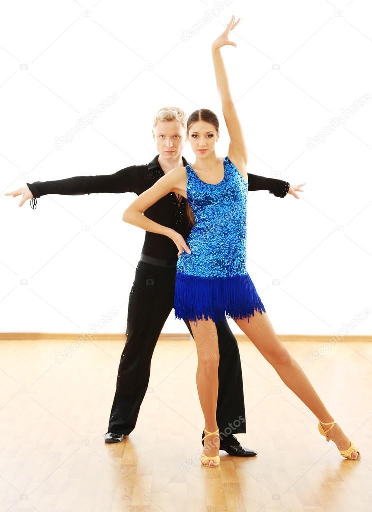 Beautiful couple in active ballroom dance, indoors