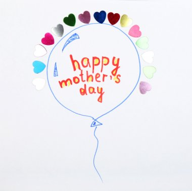 Happy Mothers Day message written on paper with bright hearts close up