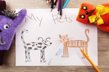 Kids drawing on white sheet of paper with toys on wooden table, closeup