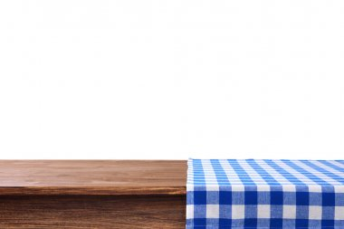 Empty wooden table with napkin