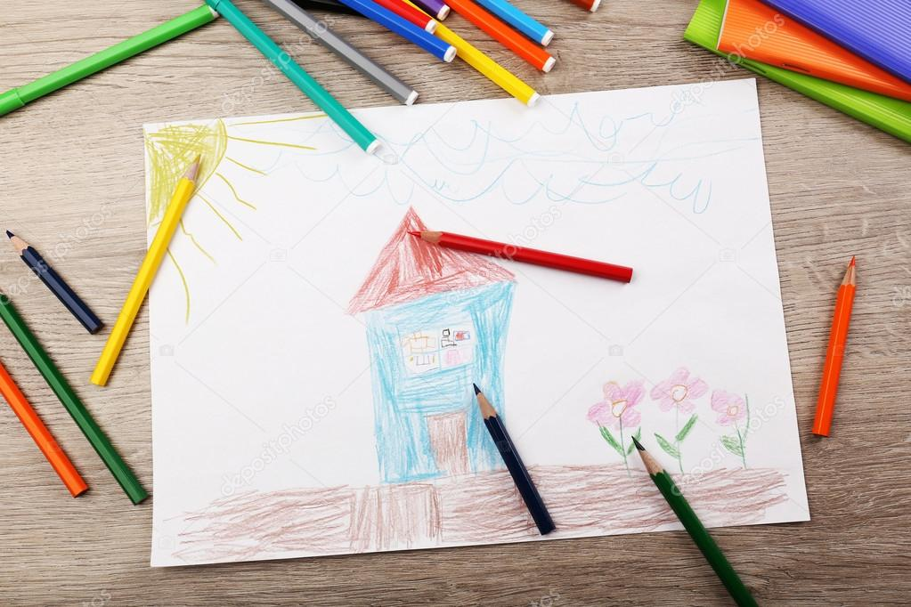 kids drawing on white sheet of paper with crayons and markers on