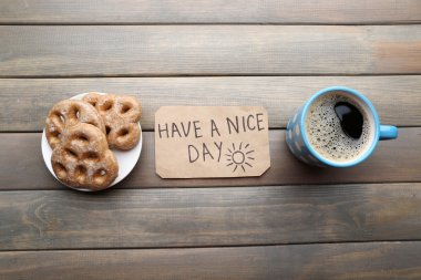 Cup of coffee with fresh croissant and Have A Nice Day massage