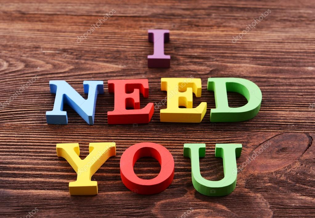 inscription i need you made of colorful letters on wooden background