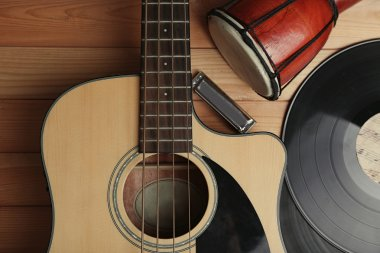 Guitar with vinyl records and African drum