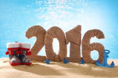 New year 2016 sign on beach sand
