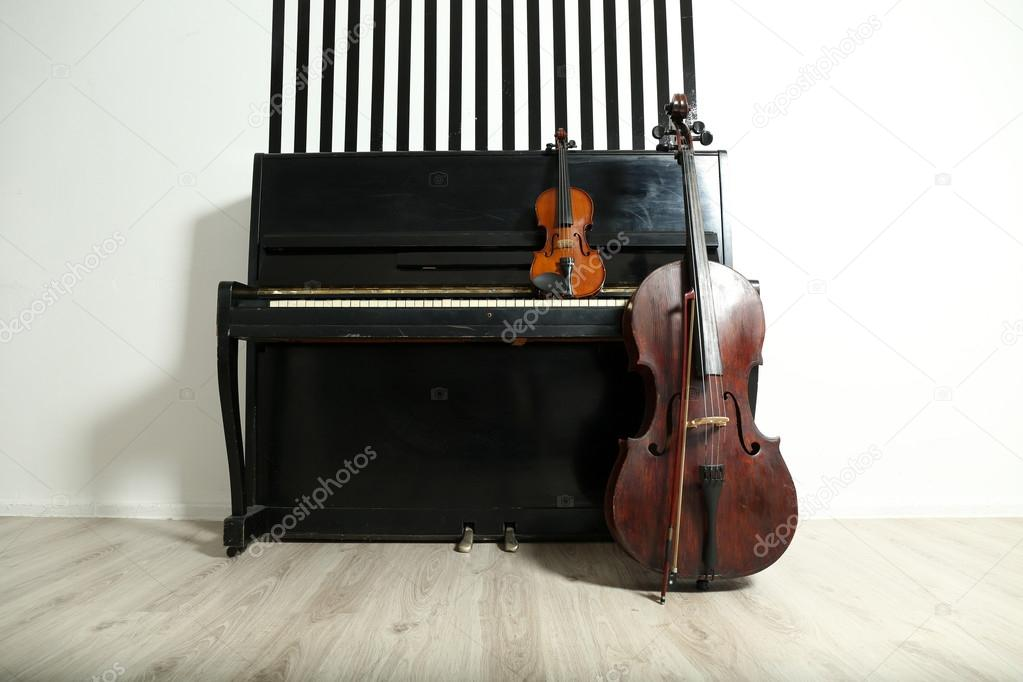 Piano, cello and violin on white wall background — Stock