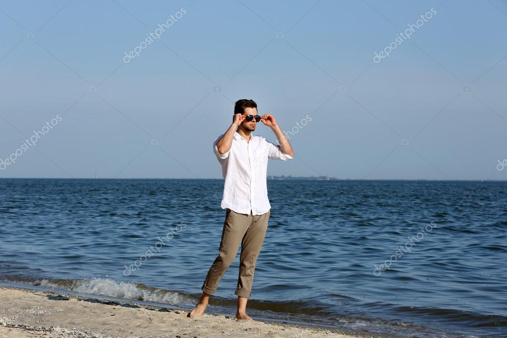 Young man walking on beach