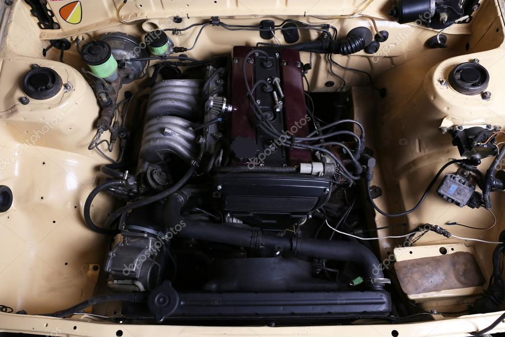 Parts under the hood of car — Stock Photo © belchonock #77198183