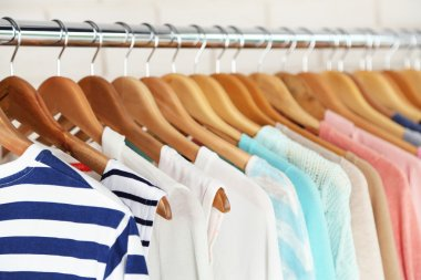 Different clothes on hangers