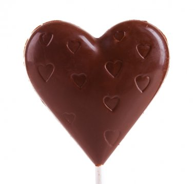 Chocolate heart shaped candy on stick isolated on white