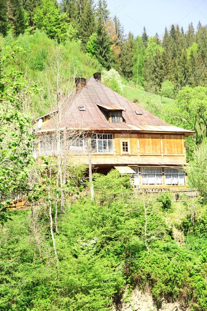 Small wooden house in mountains  Stock Photo #78077966