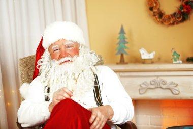 Santa Claus sitting in comfortable chair