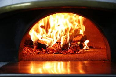 Burning firewood in traditional oven