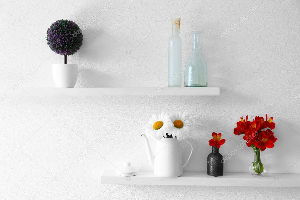 Decorative Vases With Flowers On Wooden Shelf Stock Photo
