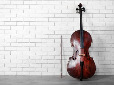 Cello on bricks wall