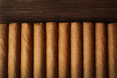Cigars on wooden table