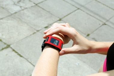 Runner looking at sports smart watch