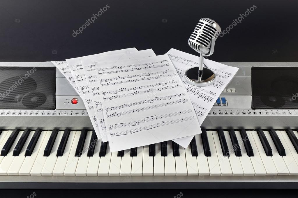 Music notes with microphone on synthesizer