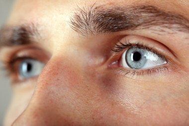 Beautiful blue man eyes