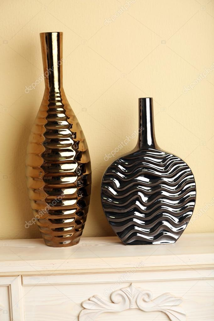 Modern Vases With Decor On Fireplace In Room Stock Photo