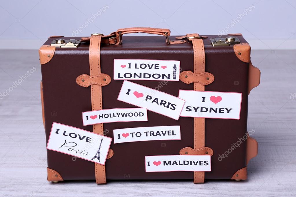 Resväska med klistermärken på golvet u2014 Stockfotografi u00a9 belchonock #80213018