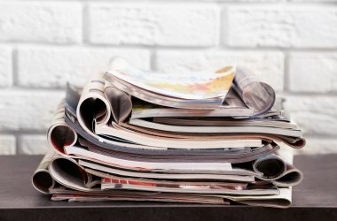 Stack of magazines on table
