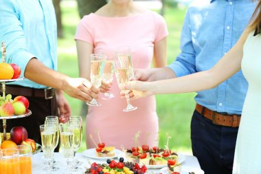 Guests drink champagne on wedding ceremony
