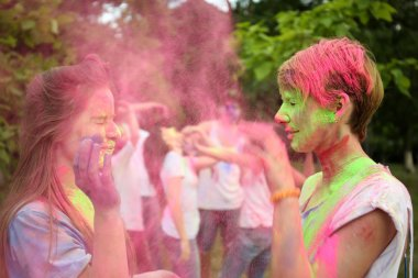 people celebrating Holi color festival