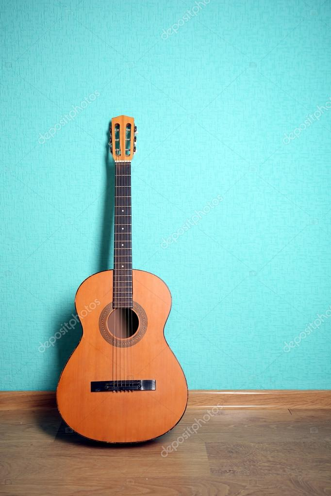 Classical Guitar On Turquoise Wallpaper Stock Photo