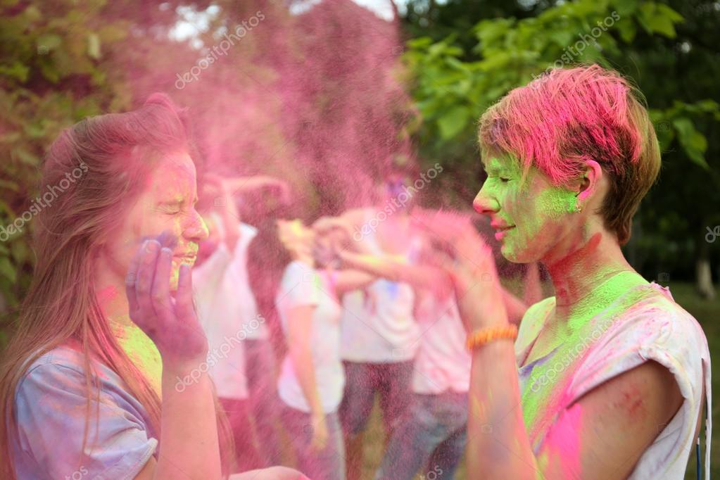 people celebrating Holi color festival