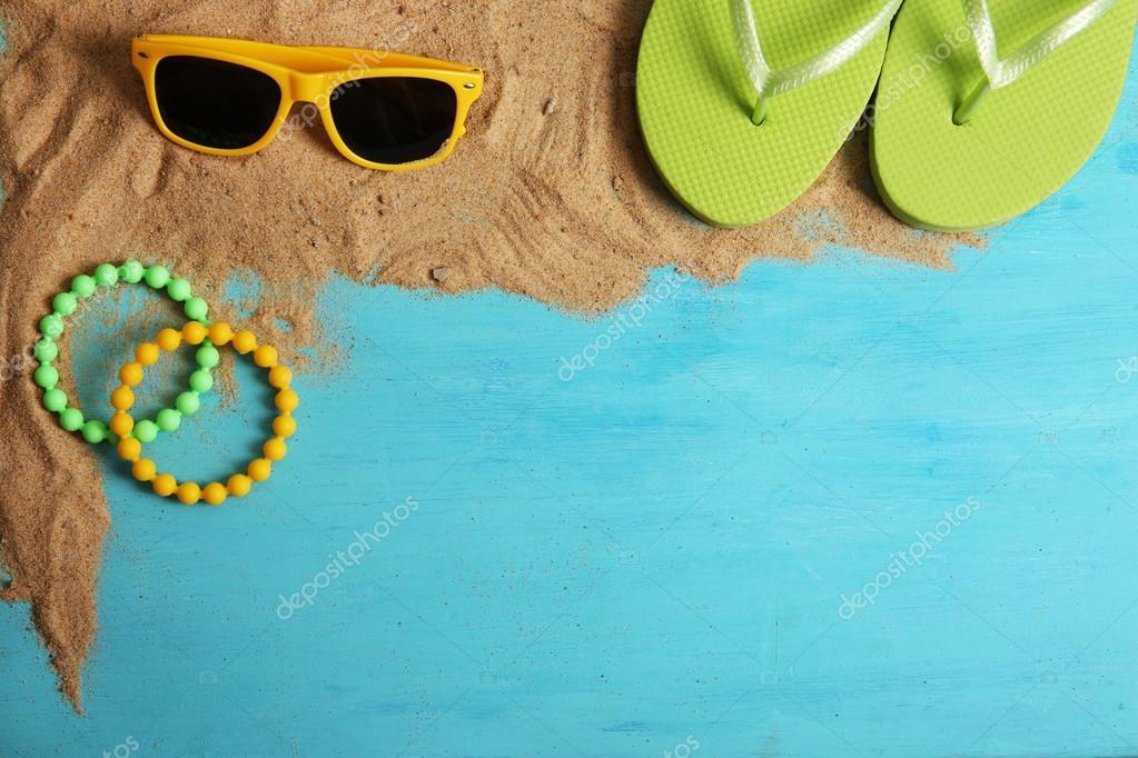 Flip flops, sunglasses and bracelets