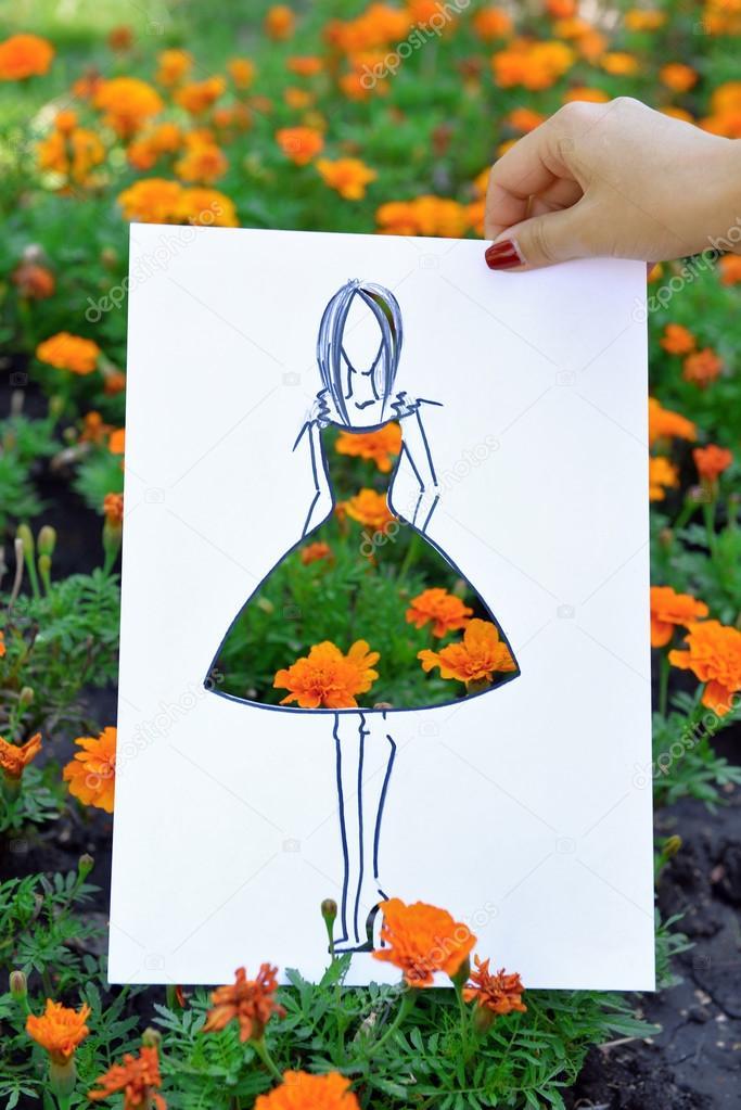 Female hand holding fashion sketch