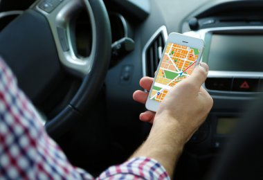Man sitting in the car with gps map